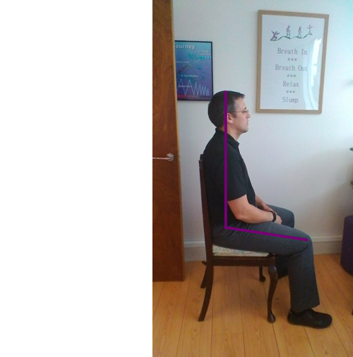 man sitting correctly in his office chair